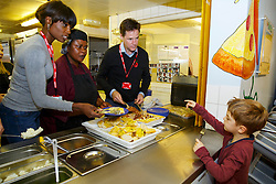 © Licensed to London News Pictures. 03/11/2014. LONDON, UK. The Deputy Prime Minister Nick Clegg and Lorraine Pascale serving lunch to school children at Weston Park Primary School in Crouch End, London on Monday 3 November 2014. Photo credit : Tolga Akmen/LNP
