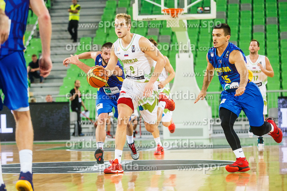 Jaka Blazic of Slovenia and Leonard Mekaj and Dardan Berisha of Kosovo during qualifying match between Slovenia and Kosovo for European basketball championship 2017,  Arena Stozice, Ljubljana on 31th August, Slovenia. Photo by Grega Valancic / Sportida