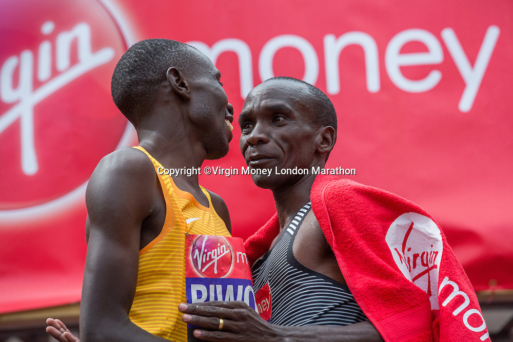 Eliud Kipchoge KEN, the winner of the Elite Men&rsquo;s Race with second place athlete Stanley Biwott KEN just after crossing the line. The Virgin Money London Marathon, Sunday 24th April 2016.<br /> <br /> Photo: Roger Allen for Virgin Money London Marathon<br /> <br /> For more information please contact media@londonmarathonevents.co.uk