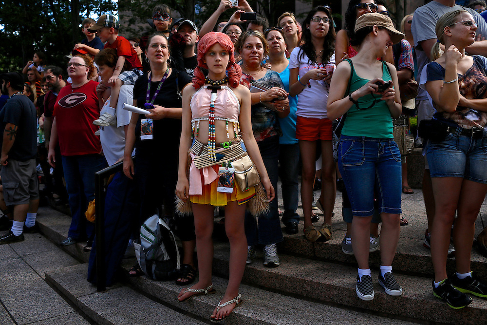 Parade goers and spectators dress as their favorite  sci-fi, gaming or movie characters during the Dragon*Con parade in downtown Atlanta on September 1, 2012.