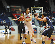 """Ole Miss' Marshall Henderson (22) vs. East Tennessee State's Mario Stramaglia (3) at the C.M. """"Tad"""" Smith Coliseum in Oxford, Miss. on Saturday, December 14, 2012. Mississippi won 77-55 to improve to 7-1. (AP Photo/Oxford Eagle, Bruce Newman).."""
