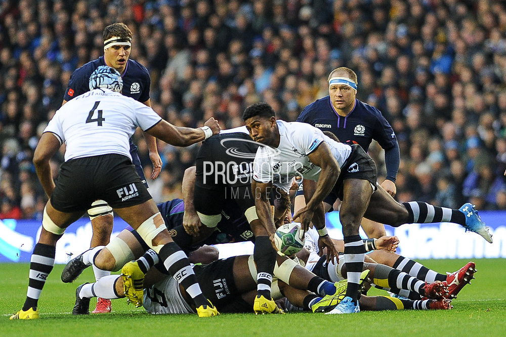 Frank Lomani passes to Tevita Cavubati during the 2018 Autumn Test match between Scotland and Fiji at Murrayfield, Edinburgh, Scotland on 10 November 2018.
