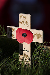 © Licensed to London News Pictures . 10/11/2013 . Bury , UK . Tributes to Drummer ( Private ) Lee Rigby of the Royal Regiment of Fusiliers , planted outside the church . Remembrance Sunday service at Bury Parish Church , Greater Manchester today (Sunday 10th November 2013) . Photo credit : Joel Goodman/LNP