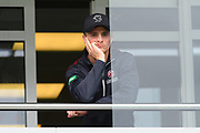 Somerset captain Tom Abell looks glum as he peers out from the dressing room balcony as the delay to the start of play continues during the Specsavers County Champ Div 1 match between Somerset County Cricket Club and Essex County Cricket Club at the Cooper Associates County Ground, Taunton, United Kingdom on 25 September 2019.