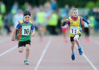 21 Aug 2016: Fergal O'Toole, left, Carlow, and Luke Charles, from Roscommon, make their way to the line in the U8 Boys 80m final.  2016 Community Games National Festival 2016.  Athlone Institute of Technology, Athlone, Co. Westmeath. Picture: Caroline Quinn