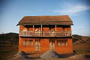 House selling gravel on the roadside between Antsaribe and Antananarivo.  Madagascar. <br /> ( Photographer &ndash; Zute Lightfoot)