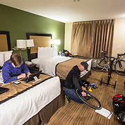 WOODSTOCK, VA - MAR 3: Marcus works on Ben's bike while Ben loads a movie on a tablet the night before his first big race of the year, The Tour of the Southern Highlands, on Friday, Mar. 3, 2017 in Woodstock, Ga. (Photo by Jay Westcott/The News & Advance)