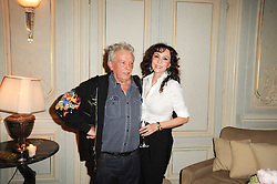 MARIE HELVIN and DAVID BAILEY at a dinner hosted by Vogue in honour of photographer David Bailey at Claridge's, Brook Street, London on 11th May 2010.