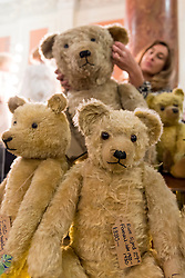 © Licensed to London News Pictures. 20/11/2016. London, UK. Collectors attend the inaugural London International Antique Doll, Teddy Bear and Toy Fair at Kensington's Olympia where dealers from around the world are presenting for sale rare and collectable dolls, teddy bears and toys from 1750-1950. Photo credit : Stephen Chung/LNP