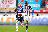 Onderwerp/Subject: SC Heerenveen - Willem II - Eredivisie<br /> Reklame:  <br /> Club/Team/Country: <br /> Seizoen/Season: 2012/2013<br /> FOTO/PHOTO: Rajiv VAN LA PARRA (R) of SC Heerenveen in duel with Tim CORNELISSE (L) of Willem II. (Photo by PICS UNITED)<br /> <br /> Trefwoorden/Keywords: <br /> #04 $94 ±1355241558607<br /> Photo- & Copyrights © PICS UNITED <br /> P.O. Box 7164 - 5605 BE  EINDHOVEN (THE NETHERLANDS) <br /> Phone +31 (0)40 296 28 00 <br /> Fax +31 (0) 40 248 47 43 <br /> http://www.pics-united.com <br /> e-mail : sales@pics-united.com (If you would like to raise any issues regarding any aspects of products / service of PICS UNITED) or <br /> e-mail : sales@pics-united.com   <br /> <br /> ATTENTIE: <br /> Publicatie ook bij aanbieding door derden is slechts toegestaan na verkregen toestemming van Pics United. <br /> VOLLEDIGE NAAMSVERMELDING IS VERPLICHT! (© PICS UNITED/Naam Fotograaf, zie veld 4 van de bestandsinfo 'credits') <br /> ATTENTION:  <br /> © Pics United. Reproduction/publication of this photo by any parties is only permitted after authorisation is sought and obtained from  PICS UNITED- THE NETHERLANDS