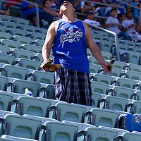Eddie Reyes, a devout Dodgers fan, is a one man cheering crew amid sections of empty seats as he watches a game against the league leading Philadelphia Phillies.