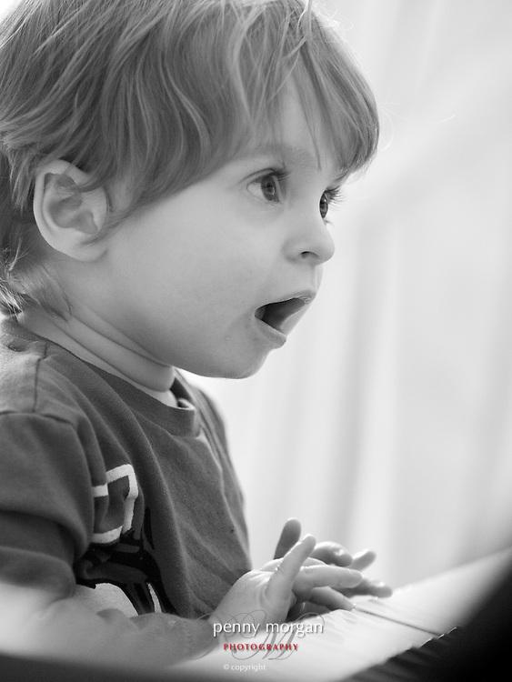 Young boy playing a piano