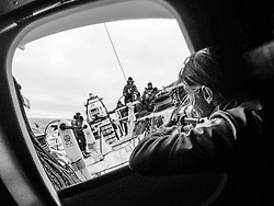 October, 2014. Leg 1 onboard Team SCA. Liz Wardley looks out the hatch before her watch begins.