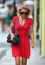 Lady in red Geri Halliwell wearing a red dress, Chanel handbag and a pair of silver high heels, seen arriving in her old classic sport Mercedes-Benz at the West London Mission Of The Methodist Church. The former Spice Girl spent about 40 minutes at the church before going to The Kabbalah Centre in London's west end. Geri left the Kabbalah Centre 3 and a half hours later and headed home... 07/09/2012<br />