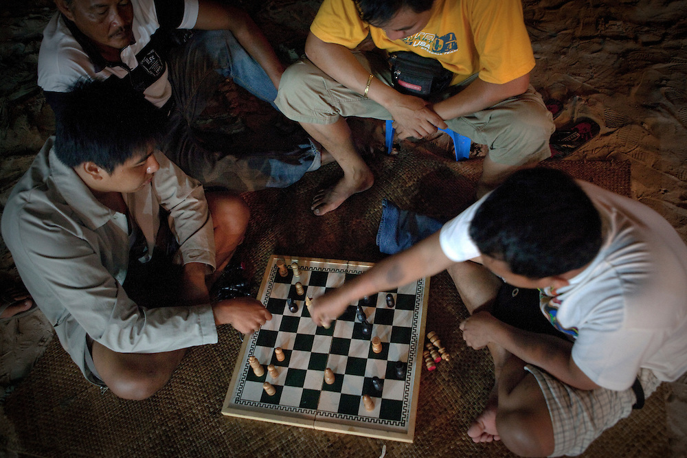 Men playing chess at night at the beach in Boracay, Philippines.