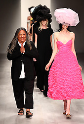 Designer John Rocha sat the end of his show at London Fashion Week for Spring/Summer 2013, Saturday, 15th September 2012 Photo by: Stephen Lock / i-Images