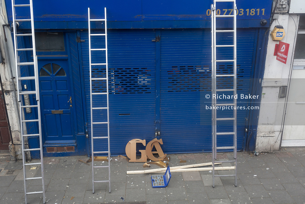 Lettering awaits installation on a shop front in Camberwell, on 27th February 2018, in London, England.