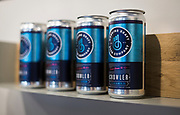 """Can growlers, or """"crowlers"""" adorn a shelf inside Working Draft Beer Company in Madison, Wisconsin, Thursday, March 22, 2018."""