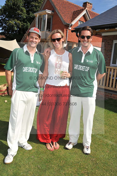 Left to right, RUPERT SPICE, JO SPICE and the HON.JAMES TOLLEMACHE at a cricket match to in aid of CARE - Corfu Animal Rescue Establishment held at Hawkley Cricket Club, Hawkley, Hampshire on 8th September 2012.