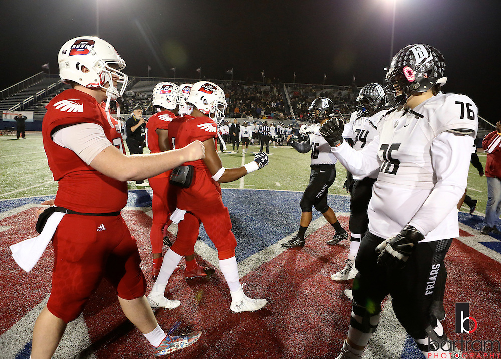 Players meet at midfield before the TAPPS Division I state championship game on Saturday, Dec. 3, 2016 at Panther Stadium in Hewitt, Texas. Bishop Lynch High School won 21-17. (Photo by Kevin Bartram)