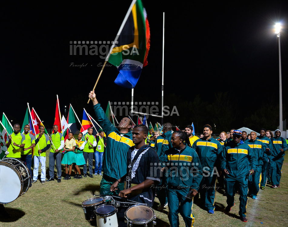 DURBAN, SOUTH AFRICA - JUNE 21: Chris Harmse holds the South African national flag aloft as Team South Africa enters the stadium during the CAA 20th African Senior Championships Opening Ceremony at Growth Point Kings Park stadium on June 21, 2016 in Durban, South Africa. (Photo by Roger Sedres/Gallo Images)