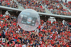 BANGKOK, THAILAND - Sunday, July 28, 2013: A Standard Chartered Credit Card in a ball during a preseason friendly match between Liverpool and Thailand at the Rajamangala National Stadium. (Pic by David Rawcliffe/Propaganda)