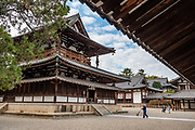 Kondo (Main Hall) at Horyuji Temple, Nara Prefecture, Japan. Horyu-ji Temple was founded in 607 by Prince Shotoku, an early promoter of Buddhism in Japan. The Kondo (Main Hall) was rebuilt in 1954 after a 1949 fire destroyed 80-85% of its wood. Horyuji Temple was founded in 607 by Prince Shotoku, an early promoter of Buddhism in Japan. Horyuji is one of the country's oldest temples and contains the world's oldest surviving wooden structures. It was designated a UNESCO World Heritage Site in 1993.