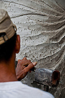 Stone carver at work in Batubulan, Bali, Indonesia