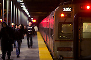 Packed with late night commuters, a South Shore electric commuter train has just dropped off several people at the Hegewisch, IL station stop and they're heading for home.