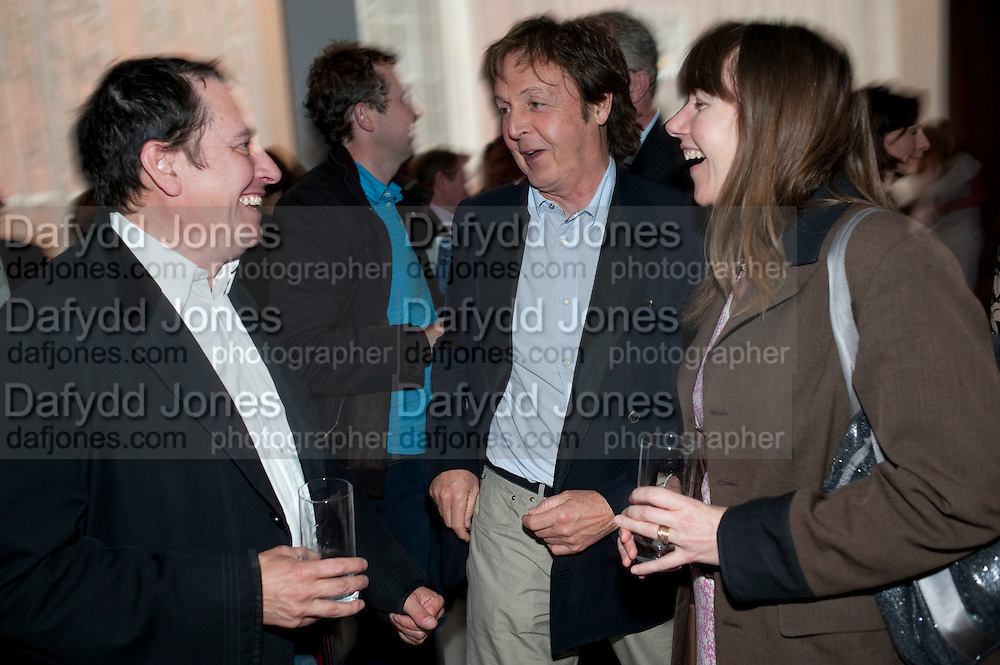 JOOLS HOLLAND; PAUL MCCARTNEY; CHRISTABEL HOLLAND; , Told, The Art of Story by Simon Aboud. Published by Booth-Clibborn editions. Book launch party, <br /> St Martins Lane Hotel, 45 St Martins Lane, London WC2. 8 June 2009