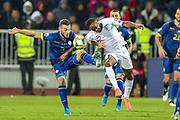 England forward Raheem Sterling tussles with Kosovo defender Fidan Aliti during the UEFA European 2020 Qualifier match between Kosovo and England at the Fadil Vokrri Stadium, Pristina, Kosovo on 17 November 2019.