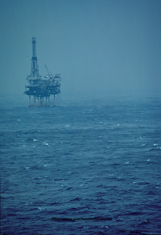 Oil rig in the Gulf of Mexico surrounded by sea fog. Gulf of Mexico, United States of America