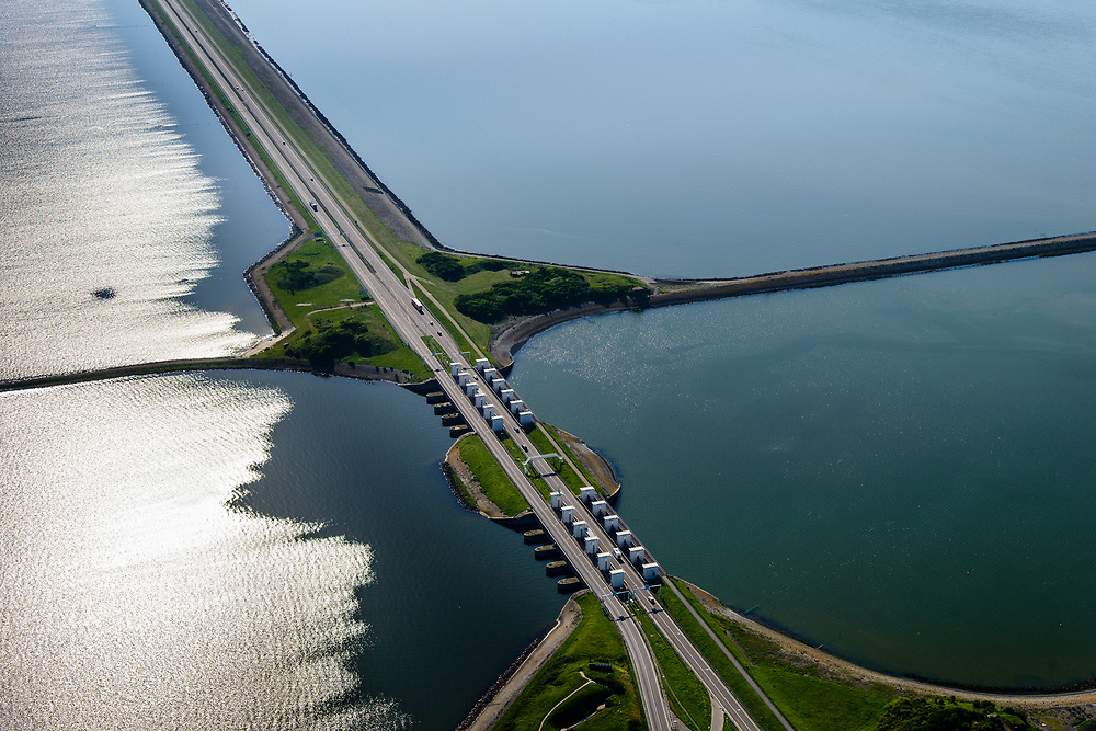 Nederland, Friesland, Gemeente Wonseradeel, 07-05-2018; Afsluitdijk ter hoogte van Kornwerderzand.<br /> IJsselmeer en Waddenzee (rechts). Lorentzsluizen, spuisluizen.<br /> Enclosure Dam near the Frisian coast. Sluices and locks. RIght Waddenzee, IJsselmeer left.<br /> luchtfoto (toeslag op standard tarieven);<br /> aerial photo (additional fee required);<br /> copyright foto/photo Siebe Swart