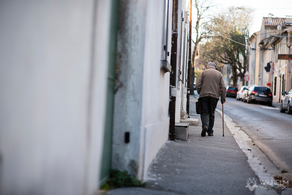 An elderly man walks down the street in St Remy de Provence, France. © Brett Wilhelm