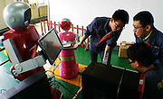 """HARBIN, CHINA - JUNE 07: (CHINA OUT) <br /> <br /> R & D personnels design robot waiters on June 7, 2015 in Harbin, Heilongjiang province of China. A Haiying robot manufacturer in north China\'s Harbin Harbin Economic and Technological Development Zone has developed into a comprehensive company where multifunctional robots could be made out to work on the land, in water and air. Liu Hasheng, chief manager and founder of the robot manufacturer, opened the first conprehensive robots restaurant in China with \""""waiters\"""" produced by his own company. According to Liu Hasheng, those robot waiters have been sold out throught out country and his orders has also a great business opportunity in the future.<br /> ©Exclusivepix Media"""