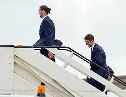 © London News Pictures. 06/06/2012. Luton, UK.  England and Liverpool players  Andy Carroll (left) and Jordan Henderson (right) boarding a plane at Luton Airport in Bedfordshire on June 6, 2012 to head to Poland for the Euro 2012 football tournament. The squads training camp is based in Krakow.  Photo credit: Ben Cawthra/LNP