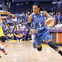 17 June 2014: Minnesota Lynx guard Tan White (5) drives past Los Angeles Sparks guard Darxia Morris (1) during the Minnesota Lynx  94-77 victory over the Los Angeles Sparks, at the Staples Center, Los Angeles, California, USA.
