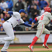 NEW YORK, NEW YORK - APRIL 08: Neil Walker, New York Mets, tags out Cesar Hernandez, Philadelphia Phillies, in a run down during the New York Mets Vs Philadelphia Phillies, Mets home opener at Citi Field on April 8, 2016 in New York City. (Photo by Tim Clayton/Corbis via Getty Images)