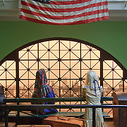 Diorama of European immigrants waiting on Ellis Island with view of New York City skyline in distance, Nordic Heritage Museum, Ballard, Seattle, Washington