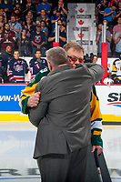 REGINA, SK - MAY 25: Humboldt Broncos president Kevin Garinger hugs Mr. Brons, the father of the late Dayna Brons, athletic therapist of the Humboldt Broncos at the Brandt Centre on May 25, 2018 in Regina, Canada. (Photo by Marissa Baecker/CHL Images)