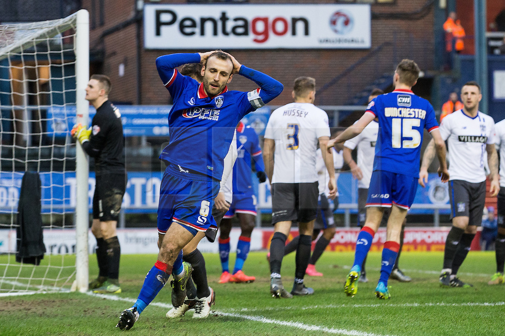 © Licensed to London News Pictures . 23/01/2016 . Oldham , UK . Oldham Captain LIAM KELLY puts his heads on his head after an unsuccessful attack on Bury . Oldham Athletic vs Bury at Boundary Park . Photo credit : Joel Goodman/LNP