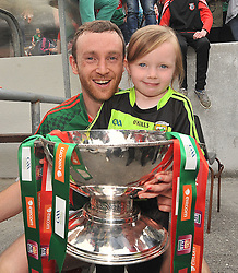 5 year old Erin Higgins congratulates her Uncle Mayo captain Keith Higgins with the Nestor Cup in Hyde Park on sunday.<br /> Pic Conor McKeown