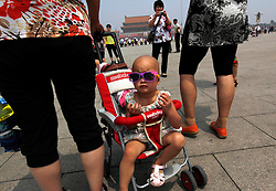 epa03248299 A Chinese baby girl wearing sunglasses looks around as visitors take photos in Tiananmen Square on of the 23rd anniversary of the Tiananmen Square massacre in Beijing, China, 04 June 2012. Hundreds, and possibly thousands, of students died in the Tiananmen Square area of Beijing in June 1989 when the Chinese government sent in troops to crush a pro-democracy uprising and preserve one-party rule in China.  EPA/HOW HWEE YOUNG