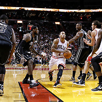 29 January 2012: Chicago Bulls point guard Derrick Rose (1) drives past Miami Heat power forward Chris Bosh (1) and Miami Heat small forward LeBron James (6) during the Miami Heat 97-93 victory over the Chicago Bulls at the AmericanAirlines Arena, Miami, Florida, USA.