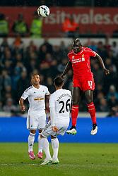 Mamadou Sakho of Liverpool heads the ball - Photo mandatory by-line: Rogan Thomson/JMP - 07966 386802 - 16/03/2015 - SPORT - FOOTBALL - Swansea, Wales — Liberty Stadium - Swansea City v Liverpool - Barclays Premier League.