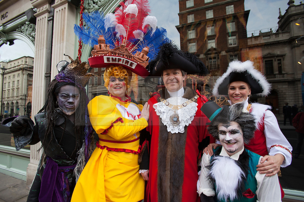 © licensed to London News Pictures. London, UK 13/11/2012. The new Mayor of London (centre) and cast members of Dick Whittington and his Cat at the Hackney Empire launching a new window of Fortnum & Mason in Piccadilly, London. Photo credit: Tolga Akmen/LNP