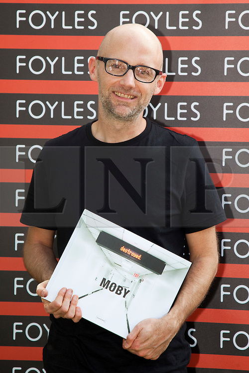 "© Licensed to London News Pictures. 01/08/2011. London, UK. Pop singer Moby promoted his new photography book ""Destroyed"" at Foyles, Southbank Centre with a book signing and he also played some songs to his fans. Photo credit: Bettina Strenske/LNP"