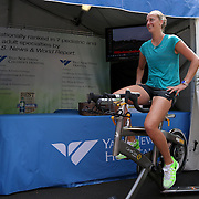 August 16, 2014, New Haven, CT:<br /> Petra Kvitova bikes on a spin bike in front of the Yale New Haven Health booth during WTA All-Access Hour on day three of the 2014 Connecticut Open at the Yale University Tennis Center in New Haven, Connecticut Sunday, August 17, 2014.<br /> (Photo by Billie Weiss/Connecticut Open)