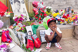 Kelvin Gray Jr., 4 of Atlanta Ga., has his photo taken at the Muhammad Ali Center memorial, Sunday, June 05, 2016.<br /> <br /> Legendary heavyweight boxing champion Muhammad Ali, a Louisville, Ky. native, died Friday, June 3, 2016. Murals and tributes could be seen across his hometown as people mourned the charismatic sports figure.
