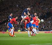 23rd March 2018, Hampden Park, Glasgow, Scotland; International Football Friendly, Scotland versus Costa Rica; Grant Hanley of Scotland outjumps Oscar Duarte of Costa Rica